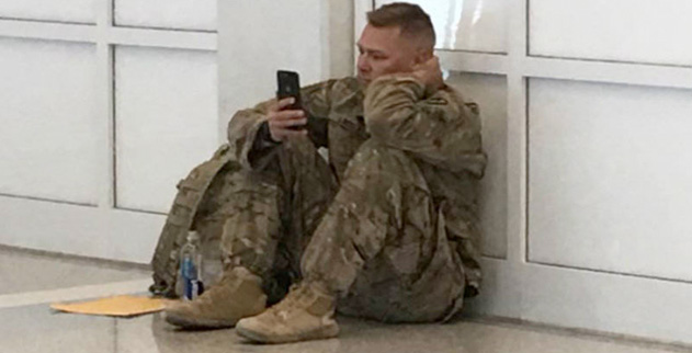 Entire Airport Cheers For Soldier Watching His Wife Give Birth Over